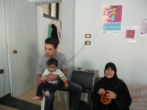 Sitting with child refugee and Ferdeel